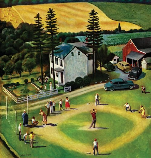 Family playing baseball in a field