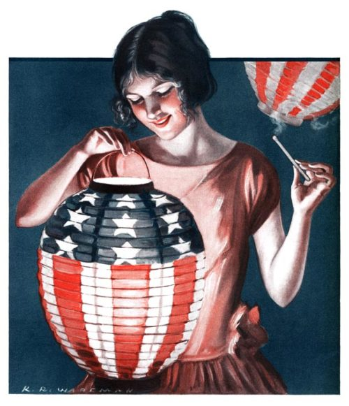 Young woman lights a Japanese paper lantern that's decorated with the U.S. flag.