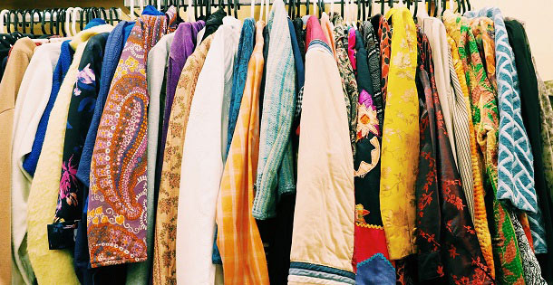 Collection of clothes on a rack.