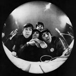 At Miami Beach press conference, John Lennon, Ringo Starr, Paul McCartney, George Harrison bug a fisheye camera.