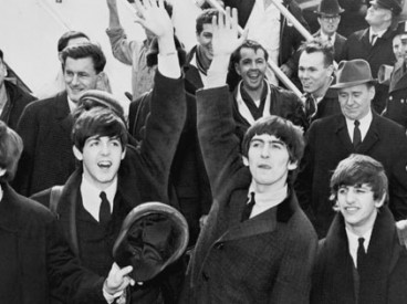 The Beatles wave to fans after arriving at Kennedy Airport on February 7, 1964. Source: United Press International, photographer unknown