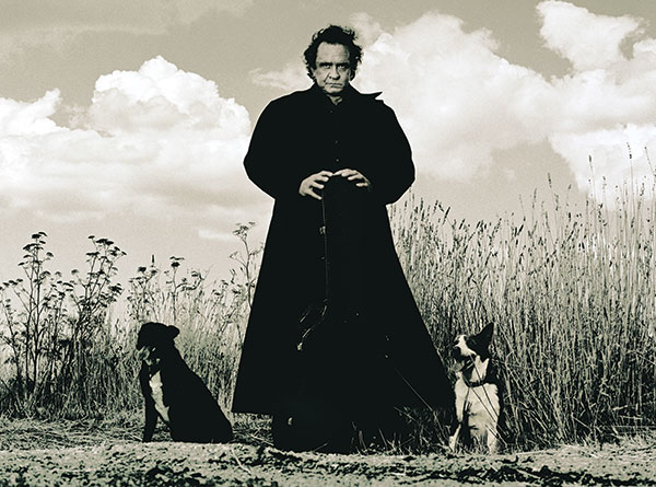 Johnny Cash with two dogs