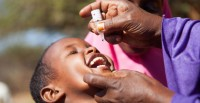 Boy Receiving Oral Polio Vaccine