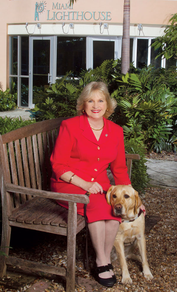 Buddies for life: President and CEO of Miami Lighthouse, Virginia Jacko, with her guide dog Tracker. (photo by Scherley Busch)