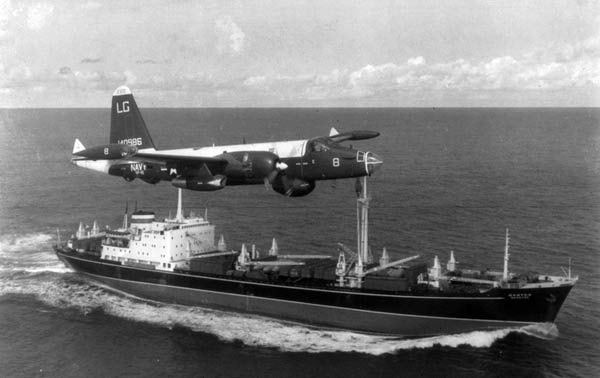 A Navy reconnaisance plane shadows a Russian freighter at the quarantine limit set by the U.S.
