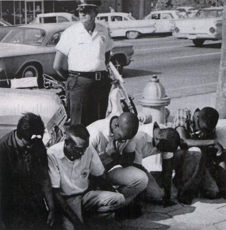 Black activists on knees
