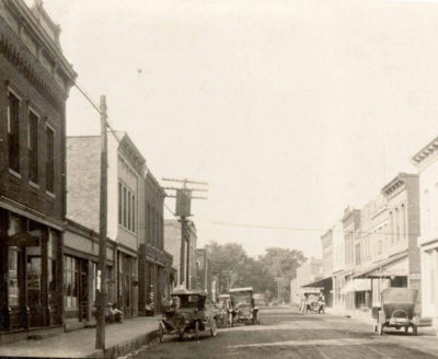 View of the same street in downtown Carlisle (Carlisle Star on left), circa 1920
