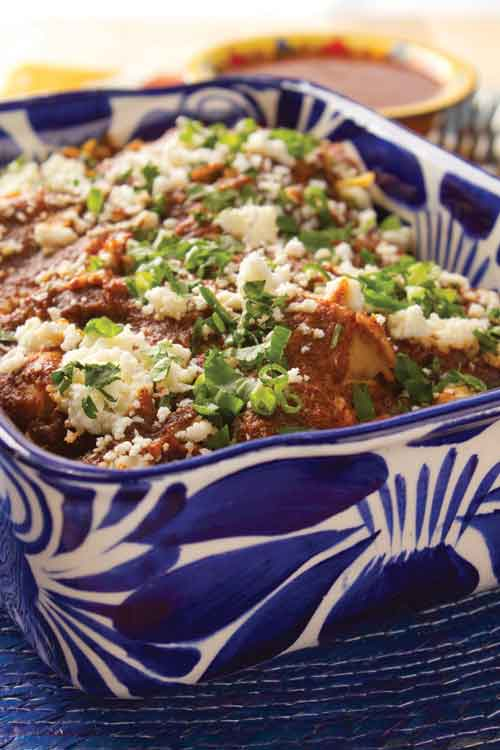Emeril Lagasse's slow-cooker layered chicken enchiladas