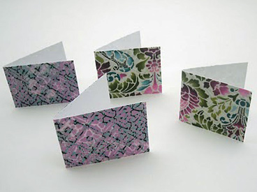 four fabric-covered cards