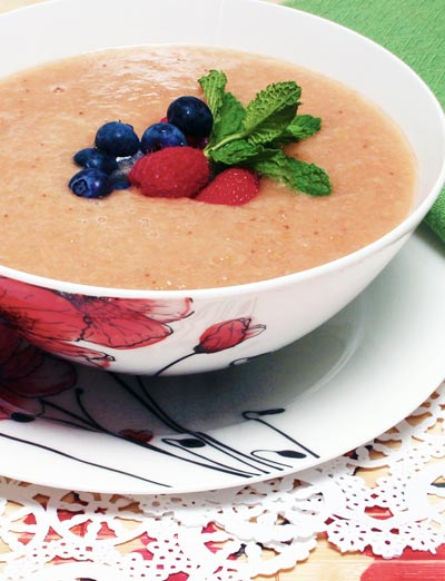 fruit soup topped with blueberries and strawberries