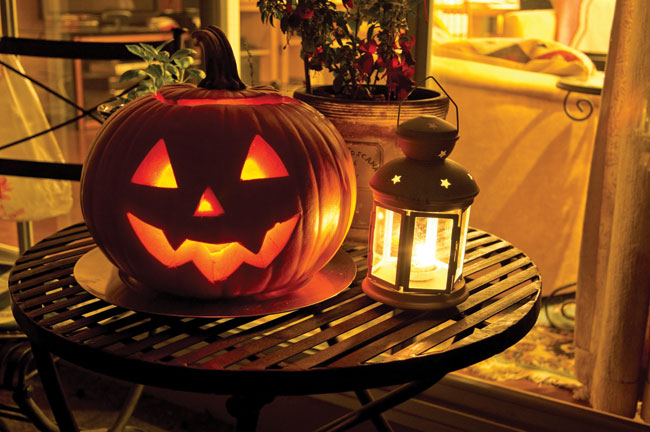 jack-o'-lantern on table with lantern