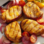 grilled pork chops with onions and tomatoes