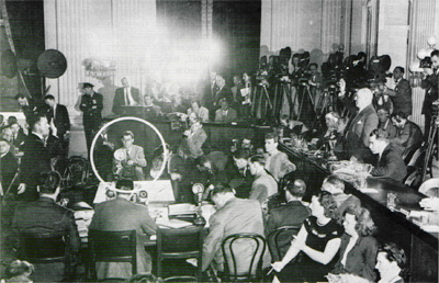 The bugaloo was everywhere.  Here, the first witness is sworn in at a House Un-American Activities Committee hearing dealing with Communist influence in Hollywood.  Rep. Richard M. Nixon sits to Rep. J. Parnell Thomas´s left.  Left of center, the author, a <em>Post</em> photographer readies his Speed Graphic