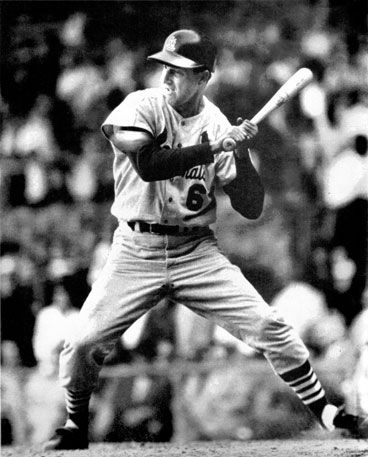 All concentration, still sturdy on the aging legs, still sharp of eye, Musial takes one tight.