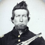 Unidentified cavalry soldier in Union frock coat with Remington New Model Army revolver