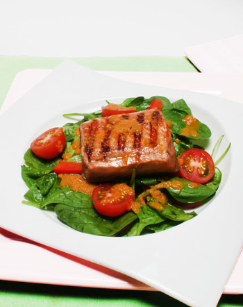 salmon, spinach, tomato salad with ginger and carrot dressing
