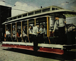 People riding streetcar.