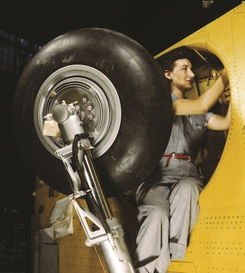 Woman mechanic working on a WW2 airplane