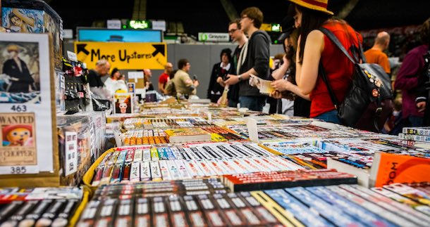 Comic convention attendees browsing Japanese manga