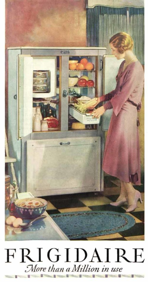 Woman taking food out of a fridge