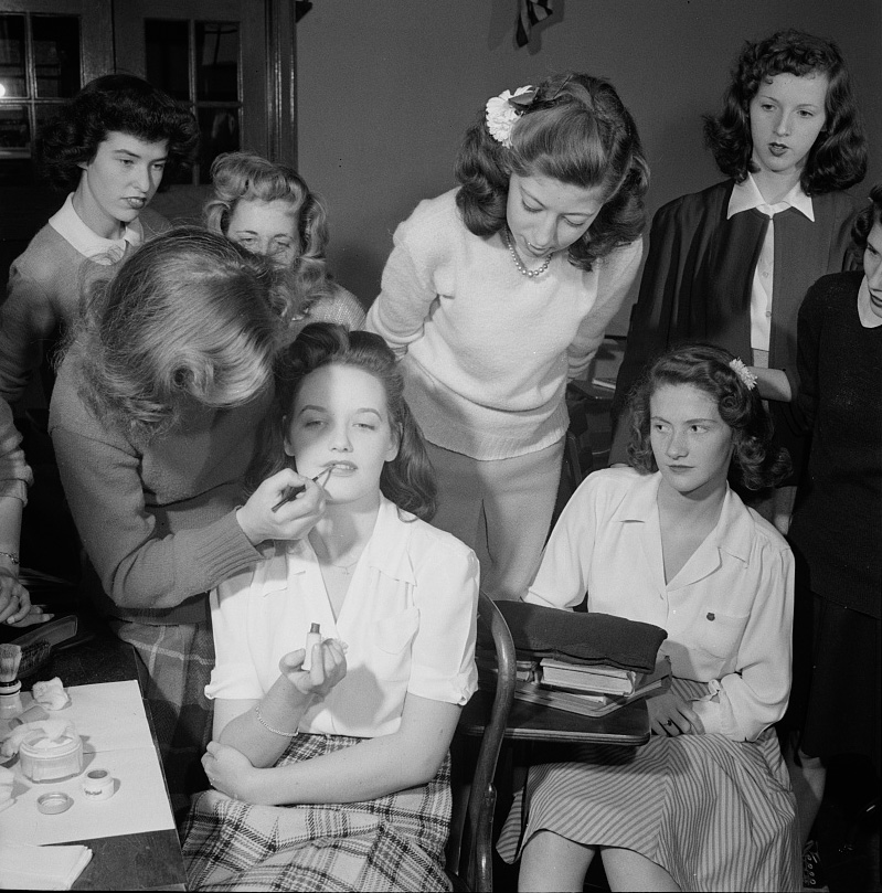 A demonstration of the correct procedure in applying street makeup in a home management class at Woodrow Wilson High School,