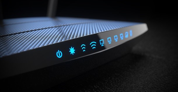 Router with all its lights on, indicating a working connection to the internet.