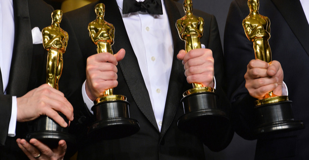 Oscar winners holding their statuettes
