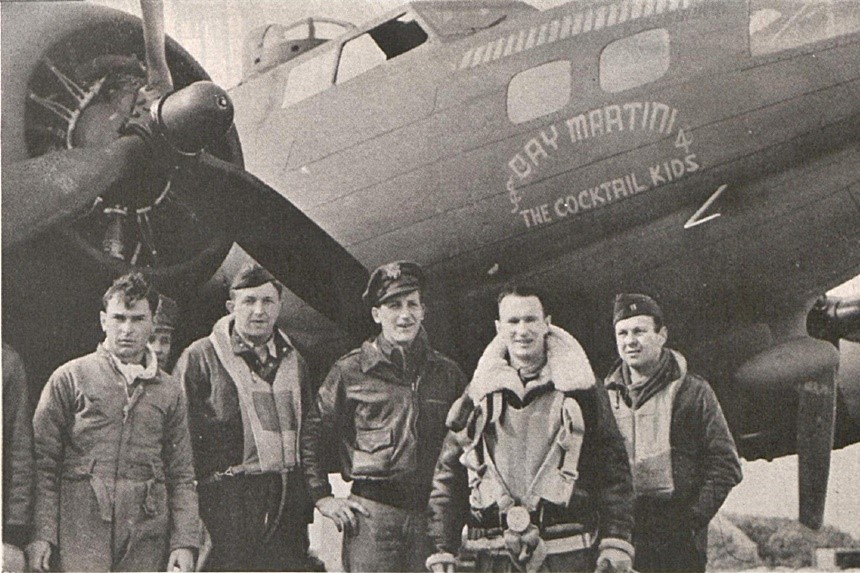 The crew of the Day Martini pose for a photo in front of their bomber