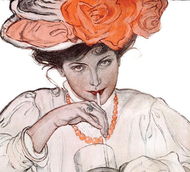 Woman sipping soda at a bar.