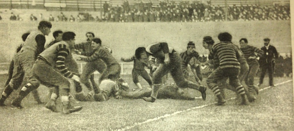 Photo of a football game. One of the players is Pudge Heffelfinger