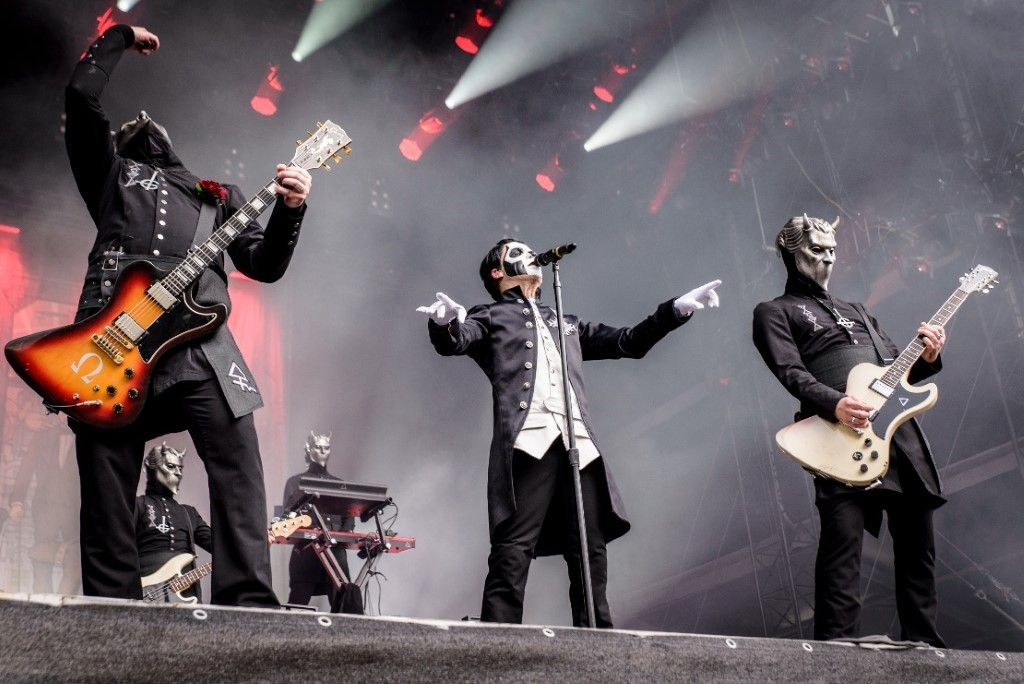 The metal band Ghost performs live on stage.