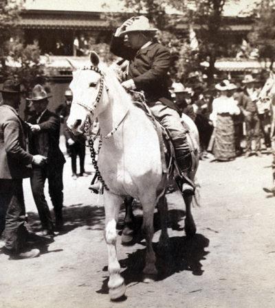 President Teddy Roosevelt riding on a horse