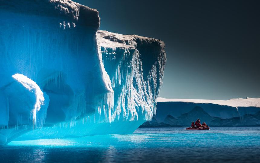 Scientists inspect an iceberg in Antarctica