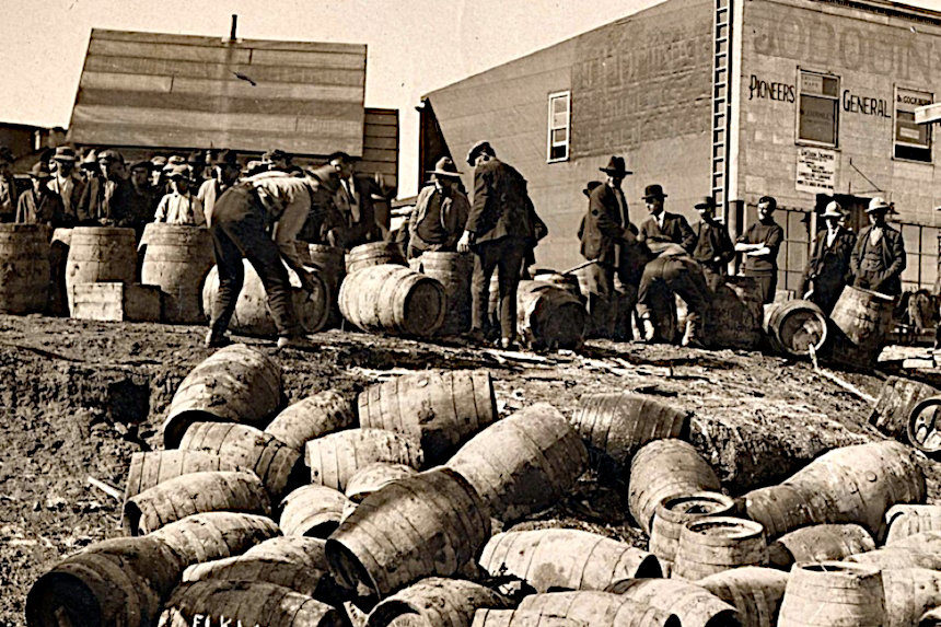 Prohibition agents seizing barrels of liquor