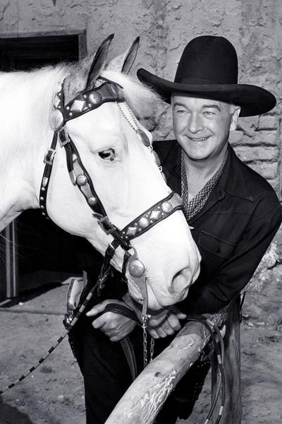 The classic western character Hopalong Cassidy with his horse.