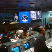 Mission Control at Houston, Texas at the end of the Apollo 11. Nixon can be seen greeting Lance Armstrong, Buzz Aldrin, and Michael Collins on a screen at the back of the room.