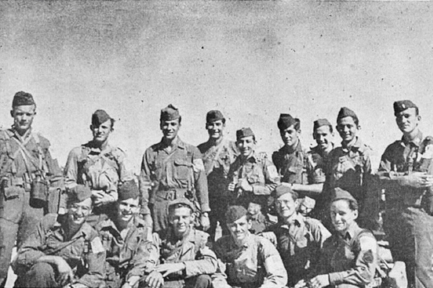 World War II soldier Paul Swank and his unit pose for a photo