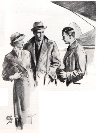 A man and a woman speak to a gentleman on an airport's tarmac.