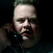 "A scene from the Clint Eastwood-directed film, ""Richard Jewell."" In this image, Jewell, played by Paul Walter Hauser, speaks into a telephone."