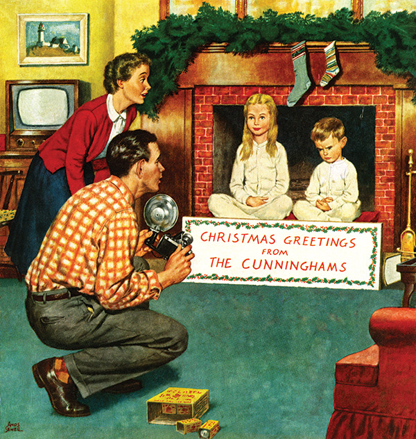 A father and mother takes a Christmas photograph of their children. Their son shows his displeasure as sits next to his patient sister.