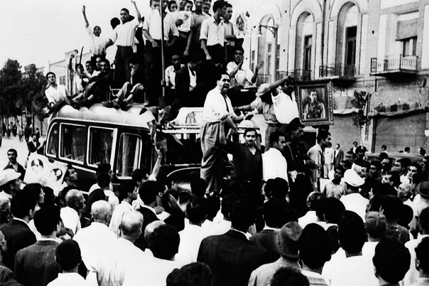 Demonstrators climb onto a bus during a Pro-Shah demonstration in 1953.