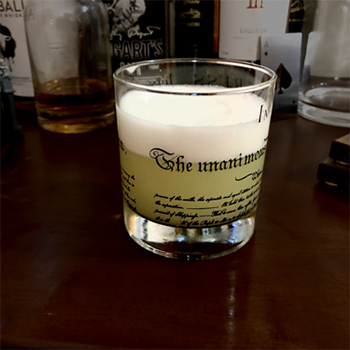 A shot glass full of gin fizz