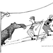 Bear rides a ski lift with two skiers.