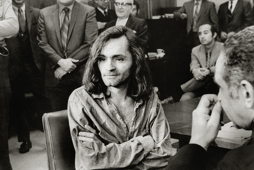 Charles Manson sits in a courtroom during his murder trial.