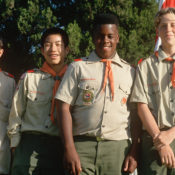 Four Boy Scouts in their uniforms posing for a photo.