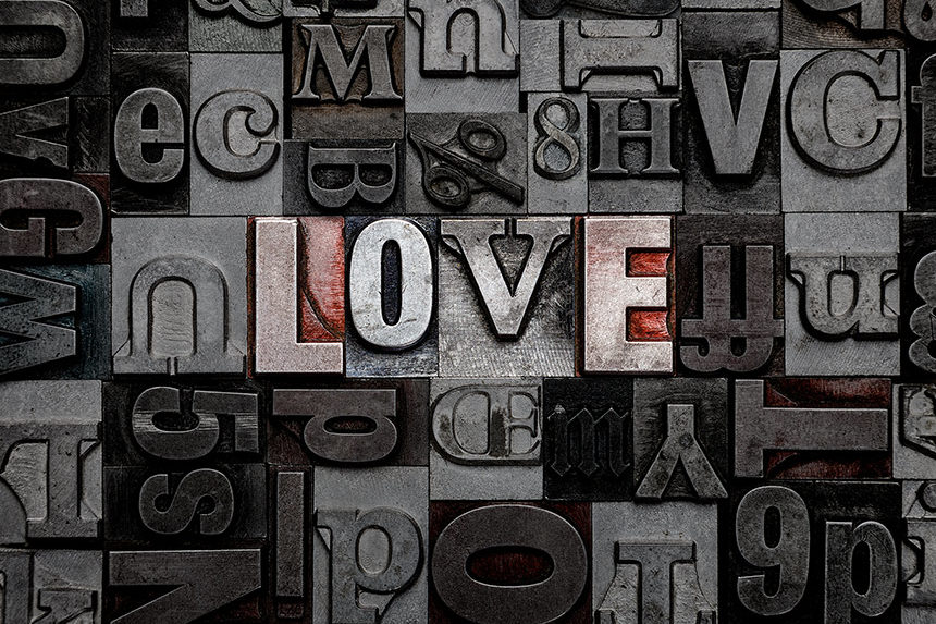 The word love in typewriter font
