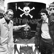 "National Lampoon chairman and Animal House producer Matty Simmons stands with Ivan Reitman on set in front of the ""Deathmobile"""
