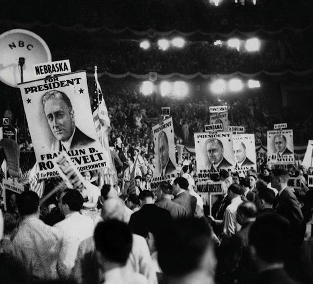 People cheering at a rally for FDR