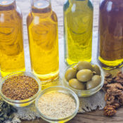 Bottles of oils and bowls of seeds