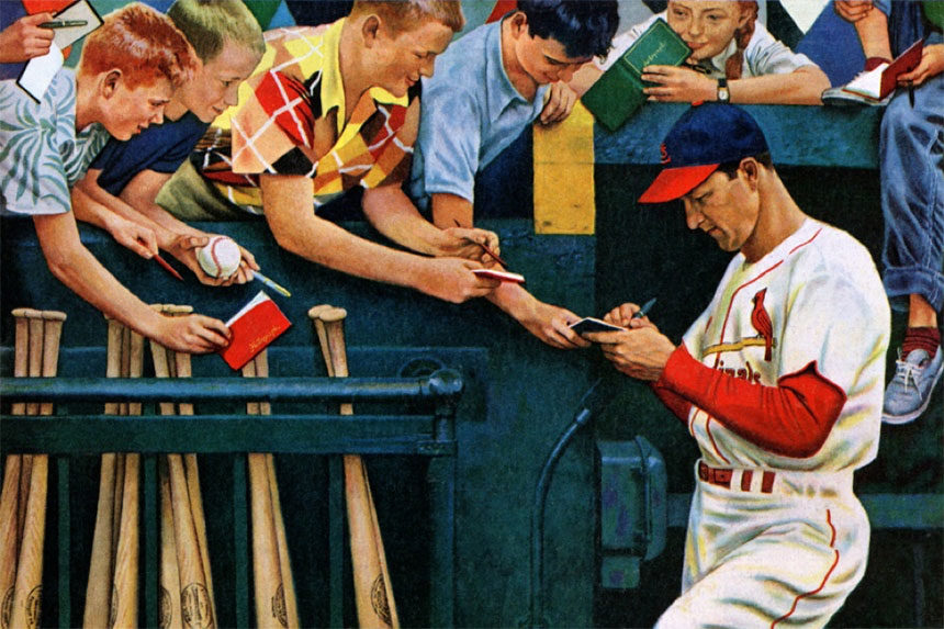 Stan Musial signing autographs for fans